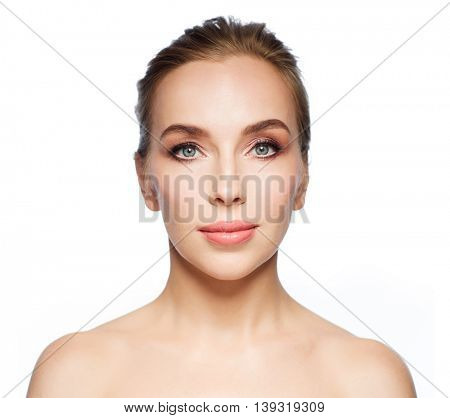 beauty, people and health concept - beautiful young woman face over white background