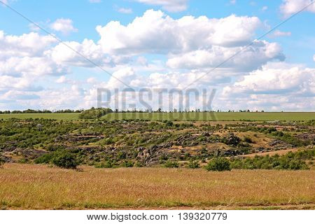 View on a valley with granite stone hills