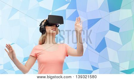 technology, virtual reality, entertainment and people concept - happy young woman with virtual reality headset or 3d glasses and headphones playing game over blue low poly texture background
