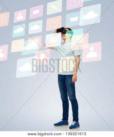 3d technology, virtual reality, entertainment, cyberspace and people concept - happy young man with virtual reality headset or 3d glasses looking at screen with menu icons