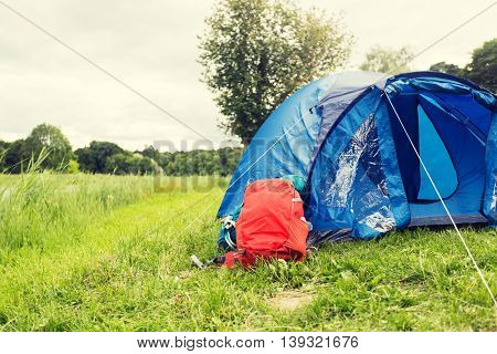 camping, travel, tourism, hike and equipment concept - touristic tent and backpack outdoors