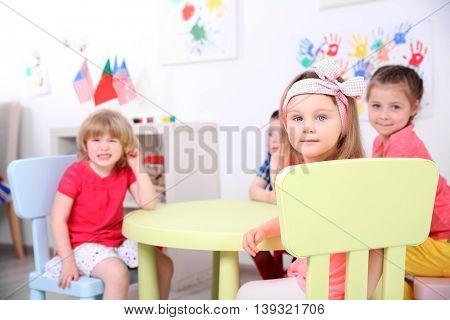 Children sitting in kindergarten