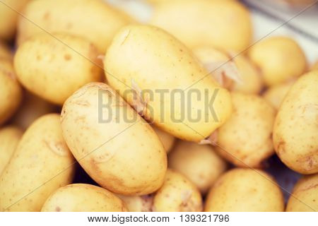 sale, harvest, food, vegetables and agriculture concept - close up of potato at street market