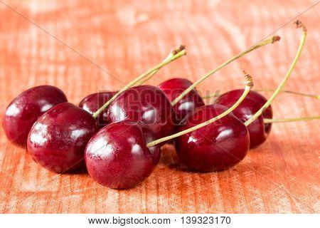 Pile of fresh cherries on wooden table