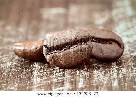 Roasted coffee beans close-up on wooden background