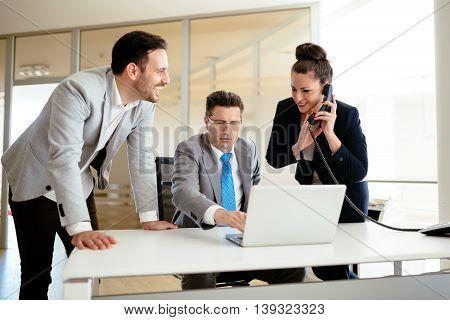 Secretaries assisting boss at business in office