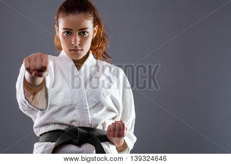 Woman Wearing Karate Kimono Throwing a Punch