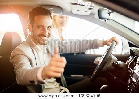 Happy customer just bought a car at car dealership