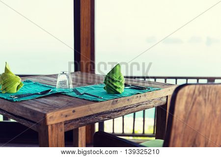 eating, service, public catering and interior concept - close up of table setting at hotel restaurant in asia