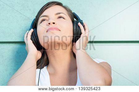 Close-up Of Young Beautiful Girl Enjoying Music On Headphones