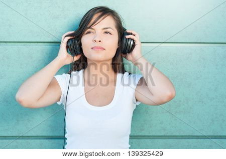 Pretty Girl Taking Or Fixing Her Headphones