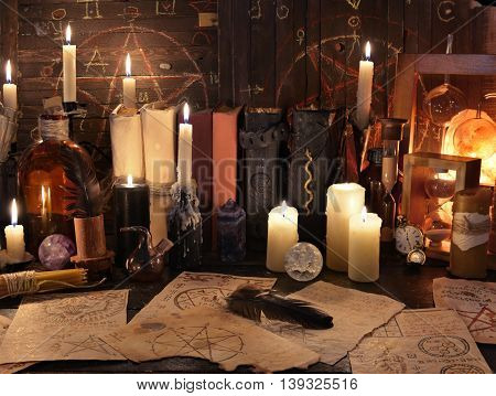 Mystic still life with magic objects and candles. Halloween concept, old alchemist or witch laboratory, scary ritual or spell with occult and esoteric symbols