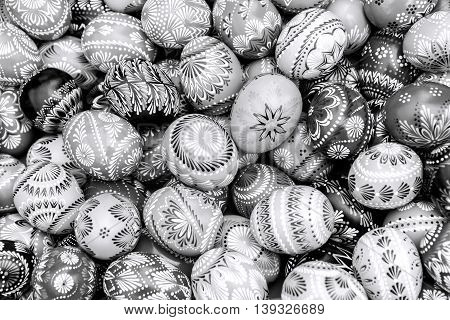 Black and white pile of decorated easter eggs full frame background