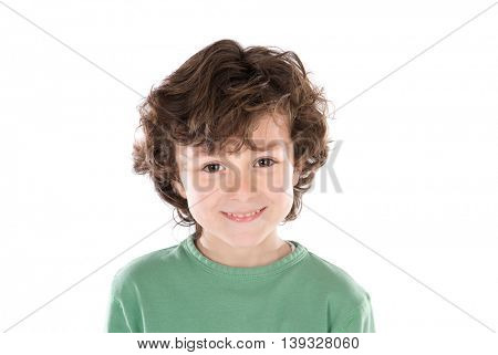 Smiling boy with six years old looking at camera isolated on a white background
