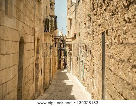 traditional narrow silent street in Mdina. Malta
