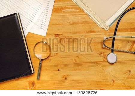 Medical doctor's general practitioner office desk top view as copy space healthcare still life