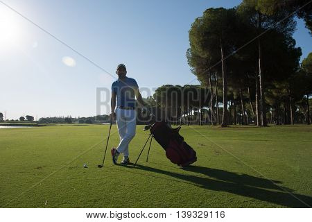 handsome middle eastern golf player portrait at course on beautiful sunset in backgeound