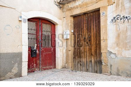 Closed traditional wooden red and brown vintage old doors. Concept of abandonment and desolation