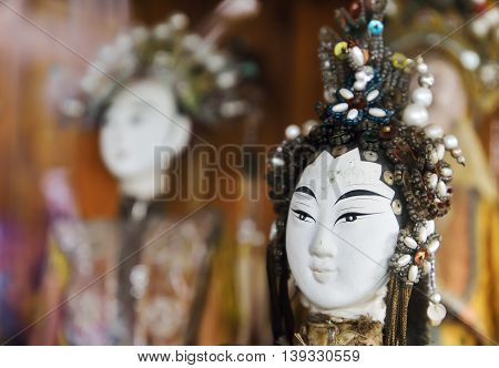 Close up of Old Traditional Chinese Dolls. (Selective focus)