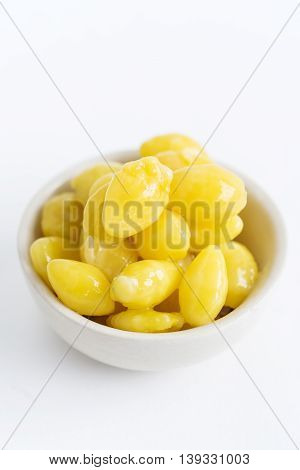 Gingko Nuts in a Bowl on White Background.