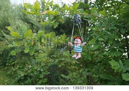 toy paratrooper parachute hung on a tree 1