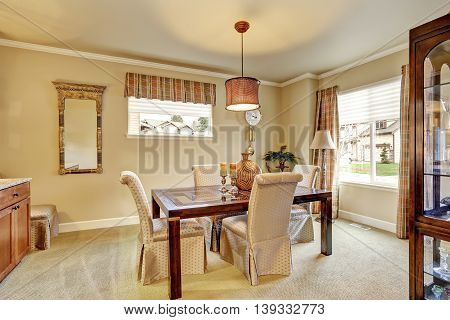 Dining Area With Beige Walls And Old Wooden Furniture