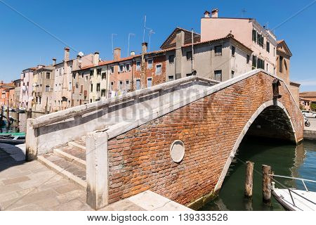 Typical bridge across a canal in Chioggia Venetian Lagoon Italy.
