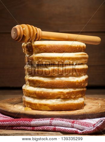 Pancakes With Honey On Wooden Background