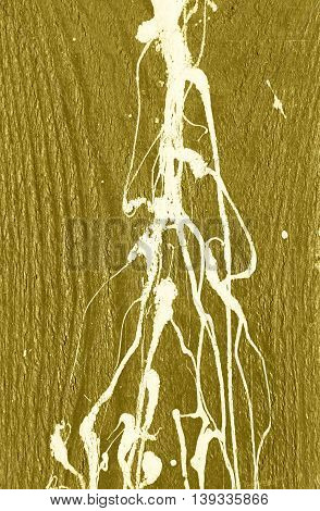 Yellow gold wooden wall with white paint drips, drops and stains. Abstract background, rough grunge wood texture, old fence wall surface, vertical image