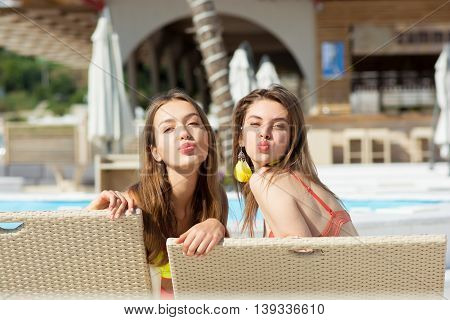 Two Cool Trendy Funny Girls In Swimwear At Beach Chairs