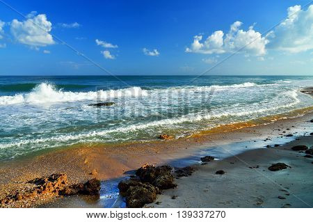 Theme: Seascape cloudy sky big waves and stones