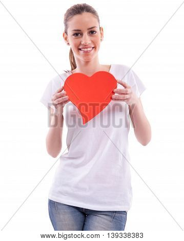 Smiling beautiful girl holding heart, isolated on white