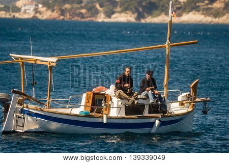Palamos, Catalonia may 2016: Fishing boat fishing in Palamos bay