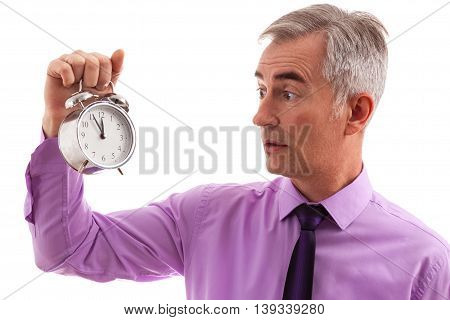 Stressed businessman holding clock in hand, isolated on white