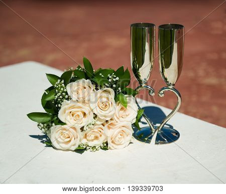 Bridal bouquet with beautiful glasses on a background of nature