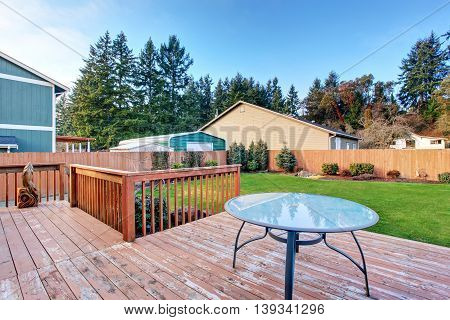 Walkout Deck With Table. Fenced Back Yard With Well Kept Lawn