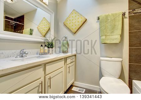Bathroom Interior With White Cabinets, Tile Floor