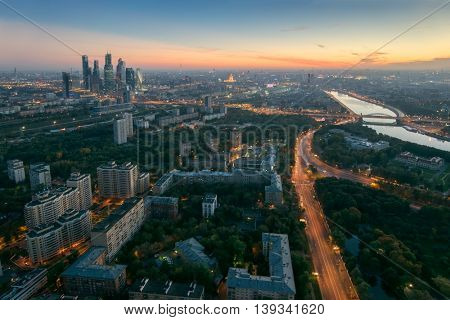 Panorama of residential district, road, river and skyscrapers during sunset in Moscow