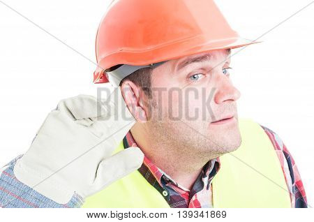 Close-up Of Constructor Holding His Ear And Listening