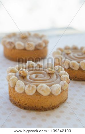 round cakes with salted caramel and nuts