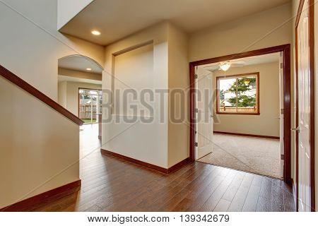Empty Hallway With Hardwood Floor, White Walls.