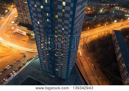 Residential building in Shchukino area and road at night in Moscow, Russia