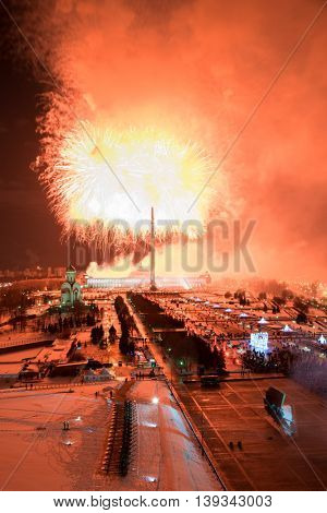 Red fireworks in Victory park on Poklonnaya hill at night in Moscow, Russia