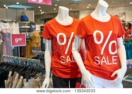 Shopping sale. seasonal discount on clothes in apparel shop store