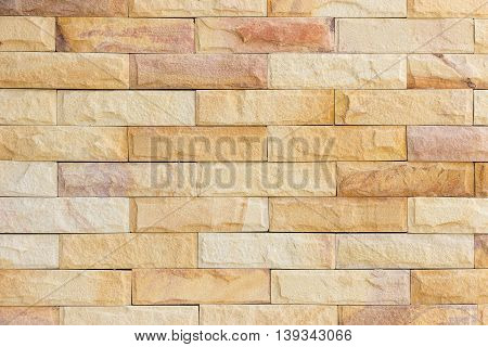 The walls are decorated with sandstone material brown color