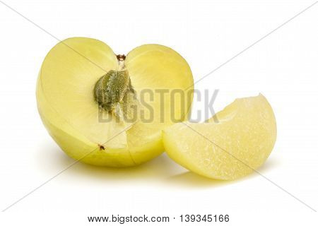 One half and a slice of Organic Indian gooseberry or Amla (Phyllanthus emblica) with visible seed isolated on white background.