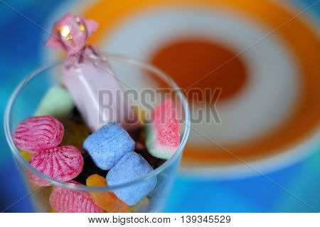 Glass with some different colorful Swedish sweets.