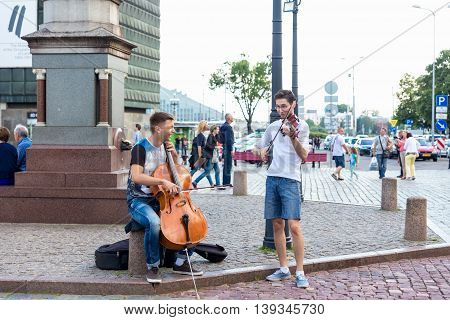 RIGA LATVIA - JULY 16: Street musicians on a Town hall square in Riga Latvia on July 16 2016