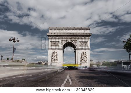 Triumphal arch. Paris. France. View of Place Charles de Gaulle. Famous touristic architecture landmark in summer day. Napoleon victory monument. Symbol of french glory. World historical heritage. Toned
