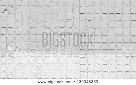 Gray concrete wall covered with stone slabs. Background for design works.